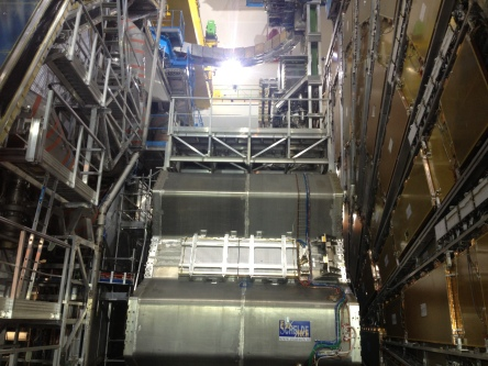 Atlas detector at CERN. The end cap toroid magnet is taken out of the inner detector (on the left) for service. The gold colored panels on the right are the muon detectors.