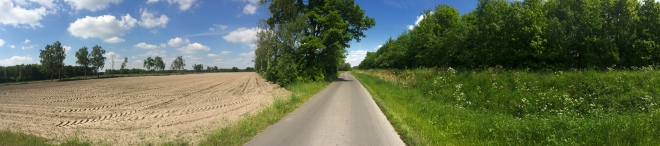 Panorama photo I took when I went cycling. About 50 meters ahead is the German border.