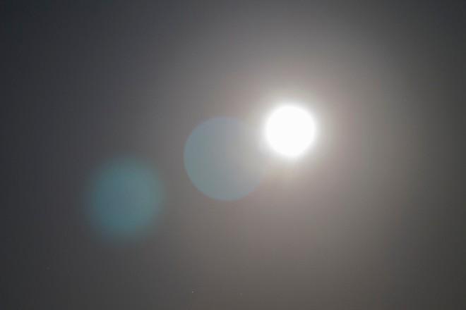 Supermoon over illuminating the night sky