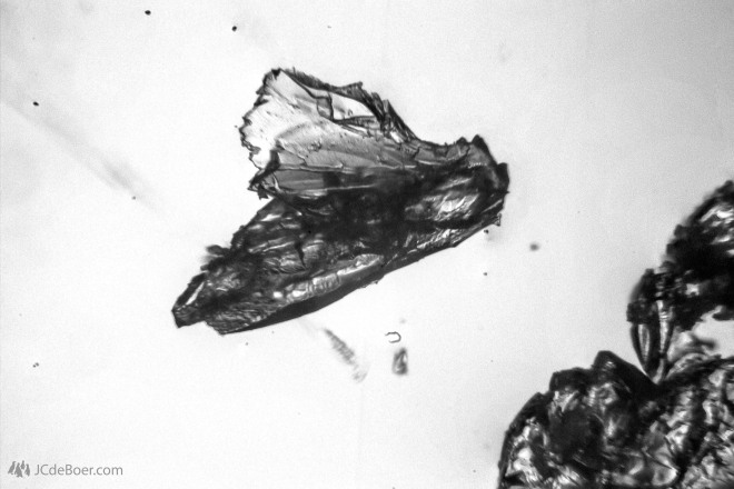 Crystallized absinthe, scraped from the bottle opening. B/W stack