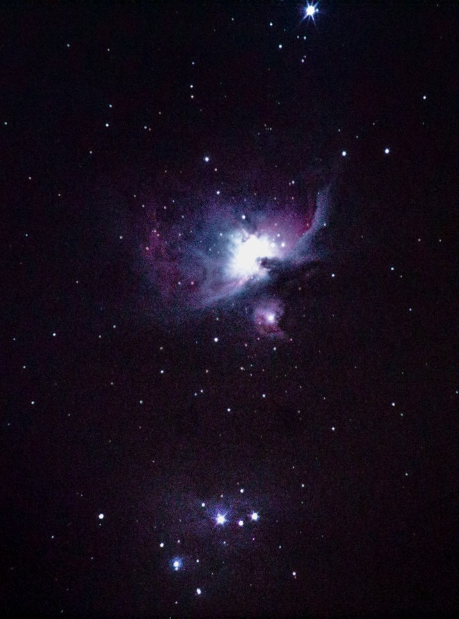 M42 taken with DSLR and tracking mount through a thin layer of clouds